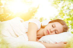 Concept of rest and relaxation. woman sleeping in bed on the bac Stock Image