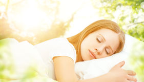 Concept of rest and relaxation. woman sleeping in bed on the bac Royalty Free Stock Photos