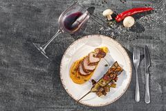 Concept: restaurant menu, healthy food, homemade, gourmet, gluttony. Beef steak with grilled vegetables and pumpkin. Sauce. Close-up. wooden background, top royalty free stock photos