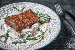 Concept: restaurant menu, healthy food, homemade, gourmet, gluttony. plate with steak and mushroom sauce on a weathered. Wooden table. Top down view. Close-up stock photos