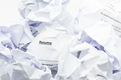 Concept of resume crumpled up and thrown away in the trash. Stock Image