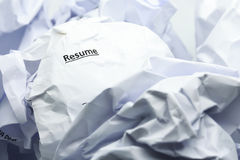 Concept of resume crumpled up and thrown away in the trash. Royalty Free Stock Image