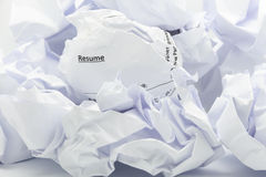 Concept of resume crumpled up and thrown away in the trash. Royalty Free Stock Images