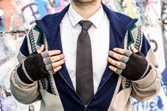Concept of rich and poor in person. Rich man who lost everything and became homeless standing in suit Royalty Free Stock Photo