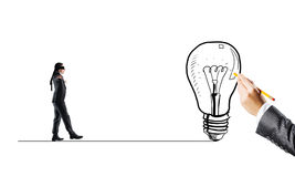 Concept of risk and difficulty with blind businessman steping carefully. Young businessman walking forward to idea on drawn line Stock Photography