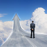 Concept of the road to success. With a businessman standing on the road Royalty Free Stock Photography