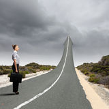 Concept of the road to success. With a businesswoman standing on the road Stock Photography