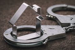 Concept on roguish actions with the real estate and its arrest.  stock photo