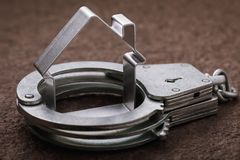 Concept on roguish actions with the real estate and its arrest. Handcuffed house figure stock photos