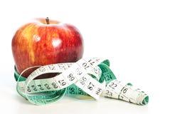 Concept rouge de fitnes de pomme de centimètre Images stock