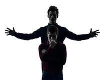Concept s de schyzophrenia de domination de deux d'hommes amis de frère jumeau images libres de droits