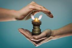 Concept safe custody of cash. Image. Golden egg in nest on stack of coin. Safety gesture. Concept safe custody of cash. Image stock image