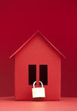 Concept - Safety real estate. Red paper house on red background. Clouseup Royalty Free Stock Images