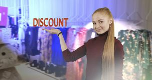 Concept of sale. Concept of discount. Pretty woman with long red hair shows her hand a symbol of the discount on the store background. Shopping stock video footage