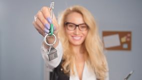 Concept of sale and lease of real estate. Realtor is giving the keys to an apartment to clients. Realtor is giving the keys to an apartment to clients. Focus on stock footage