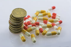 Concept of sanitary copayment. Money and medicines Royalty Free Stock Image