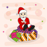 Concept of Santa sitting on gift box. Royalty Free Stock Photos