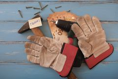 Concept satisfaction with craftsman. Handyman tools on blue-painted boards with 50-euro notes and a note `thanks Royalty Free Stock Photos