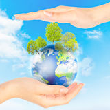 Concept Save green planet. Hands and Earth. Concept Save green planet. Symbol of environmental protection Stock Photo