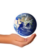 Concept Save the world - hand around earth Stock Photography