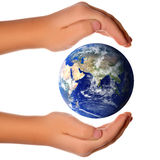 Concept Save the world - hand around earth Stock Image