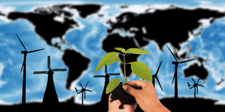 Concept save the world ,wind turbine on map the earth, Royalty Free Stock Photo