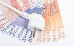 Concept of saving electricity at home. Euro banknotes and plug. Euro currency and plug. Concept of saving electricity at home Royalty Free Stock Photography