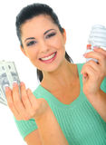 Concept Of Saving Energy Bill. Save energy concept. young woman holding bulb and money royalty free stock photo