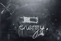 Concept saving energy chalk text battery black. Concept saving energy chalk text sketching black background symbol charging battery copy space Stock Photo