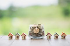 Concept of saving money for house, Savings money for buy house and loan to business investment for real estate concept. Invesment royalty free stock images