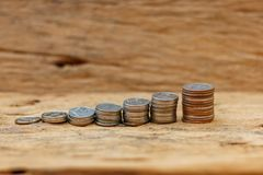 The concept of saving money on the old wooden floor.  stock photos