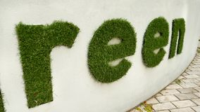 The concept of saving nature. Go Green. Green letters and hashtag from the grass. stock footage