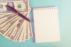 Concept savings, finances, economy . One dollars banknotes isolated on blue backround. Toned. Concept savings, finances, economy . One dollars banknotes stock image
