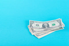 Concept savings, finances, economy . One dollars banknotes isolated on blue backround. Concept savings, finances, economy . One dollars banknotes isolated on stock images