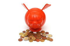 Concept of savings with piggy and coins Stock Images