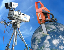 Concept saw cutting earth globe under camera view Stock Images