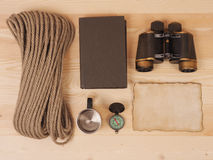 Concept. scene expedition in retro style. On wood background Stock Images
