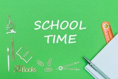 Text school time, school supplies wooden miniatures, notebook with ruler, pen on green backboard. Concept school, text school time, school supplies wooden Royalty Free Stock Photos