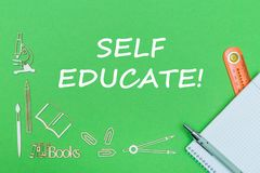Text self educate, school supplies wooden miniatures, notebook with ruler, pen on green backboard. Concept school, text self educate, school supplies wooden Royalty Free Stock Image