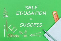 Text self education success, school supplies wooden miniatures, notebook with ruler, pen on green backboard. Concept school, text self education success, school Royalty Free Stock Photos