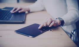 Concept of searching for new business solution.Pensive young beautiful businesswoman using tablet and laptop while Stock Images