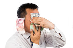 Concept of see, speak, hear no evil with money Stock Images