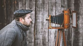 Concept - selfie. Selfie of old fashioned man on large format camera royalty free stock image