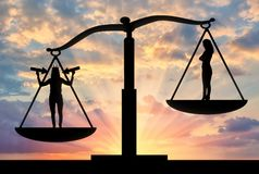 Concept of a selfish and narcissistic personality. Silhouette of a selfish woman with a crown on her head in priority on the scales of justice with an ordinary Stock Images