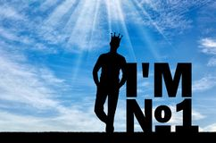 Concept of selfishness and narcissistic personality. Silhouette of a selfish and narcissistic man with a crown on his head near the word, I`m number one. The Stock Photo