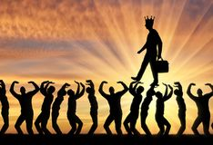 Concept of selfishness and narcissistic personality. Silhouette of a walking selfish and narcissistic man with a crown on his head on the hands of the crowd. The Stock Photo