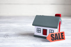Concept of selling home on wooden background Stock Photo
