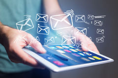Concept of sending email on tablet interface with message icon a Royalty Free Stock Images