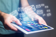 Concept of sending email on tablet interface with message icon a Stock Photography