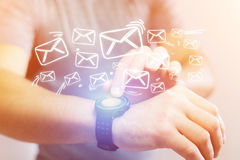 Concept of sending email with a technology  smartwatch interface Royalty Free Stock Image